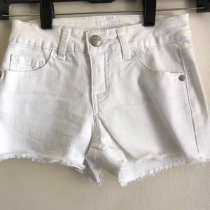White shorts just in time for pool parties
